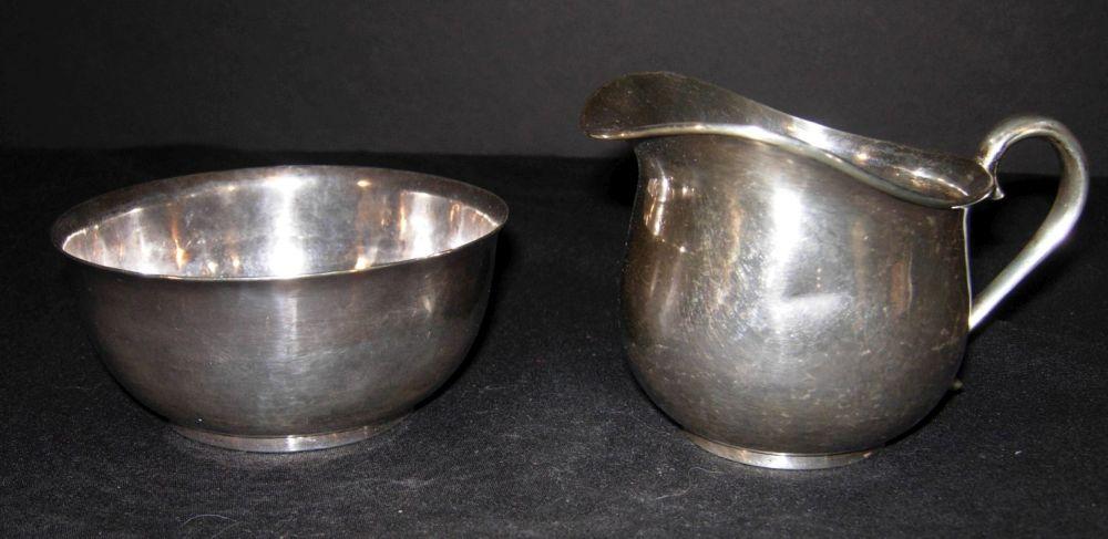 Sterling silver creamer and sugar bowl